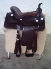 Saddles and girths made of leather for riding and