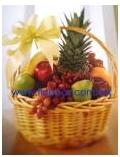 Arreglos de canastas con flores y fruta